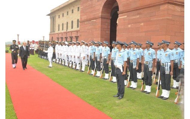 French Minister of Defence inspects a guard of honour during a welcoming ceremony at the Ministry of Defence in New Delhi