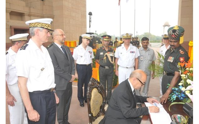 French Minister of Defence signing the visitors book